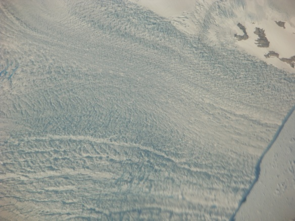 Close up on a tongue of glacier flowing to the ocean.